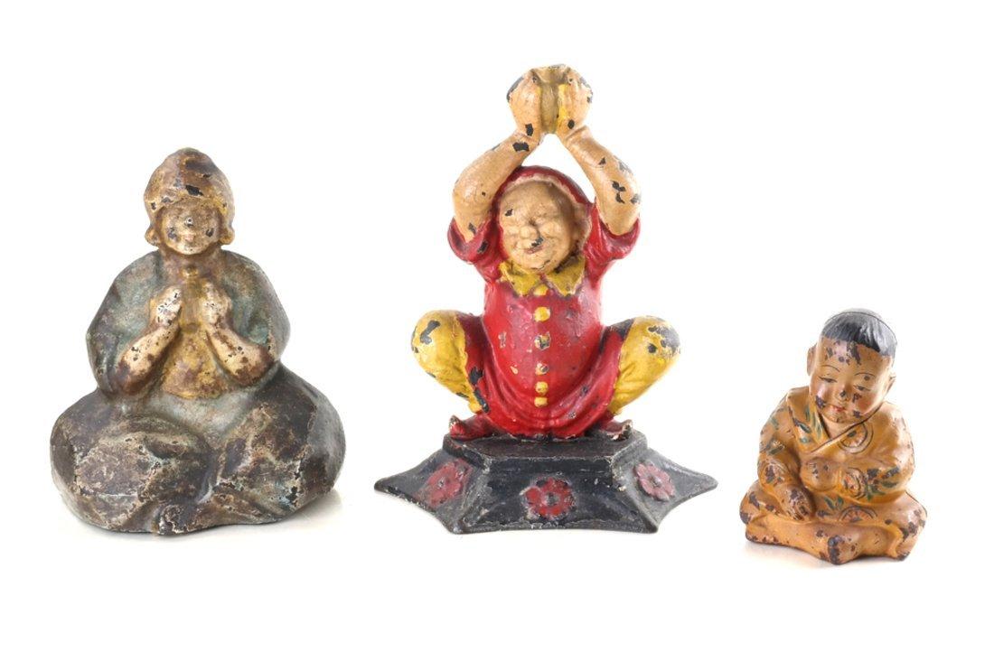 Three Cast Iron Asian Inspired Figures