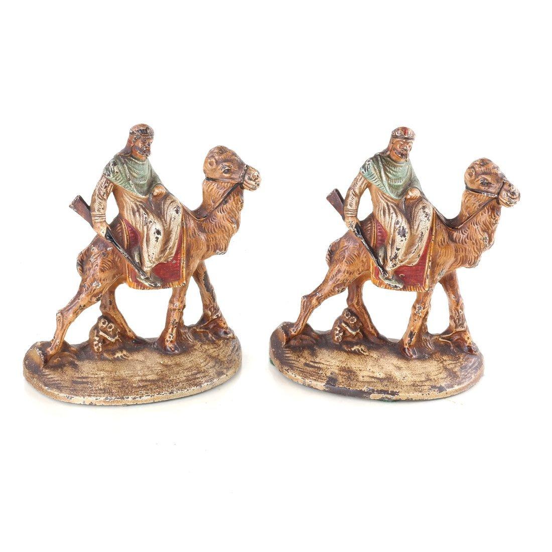 Seven Cast Metal Camel Figures - 7