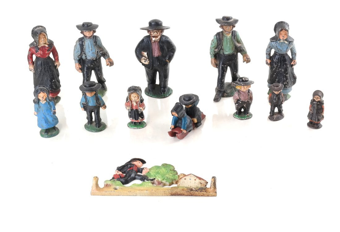 Fifteen Painted Cast Iron Amish Figures