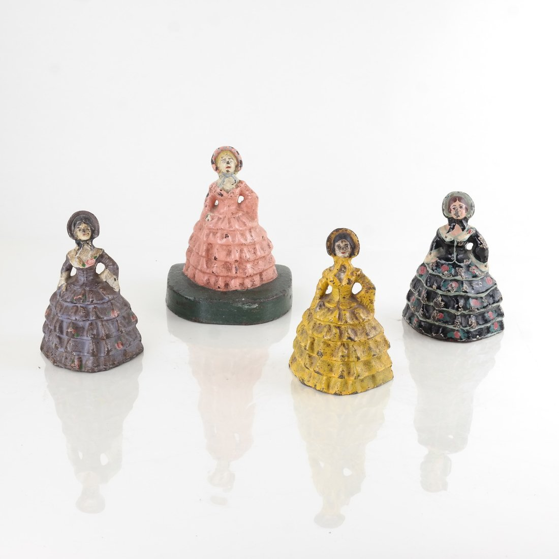 Four Painted Cast Iron Ladies