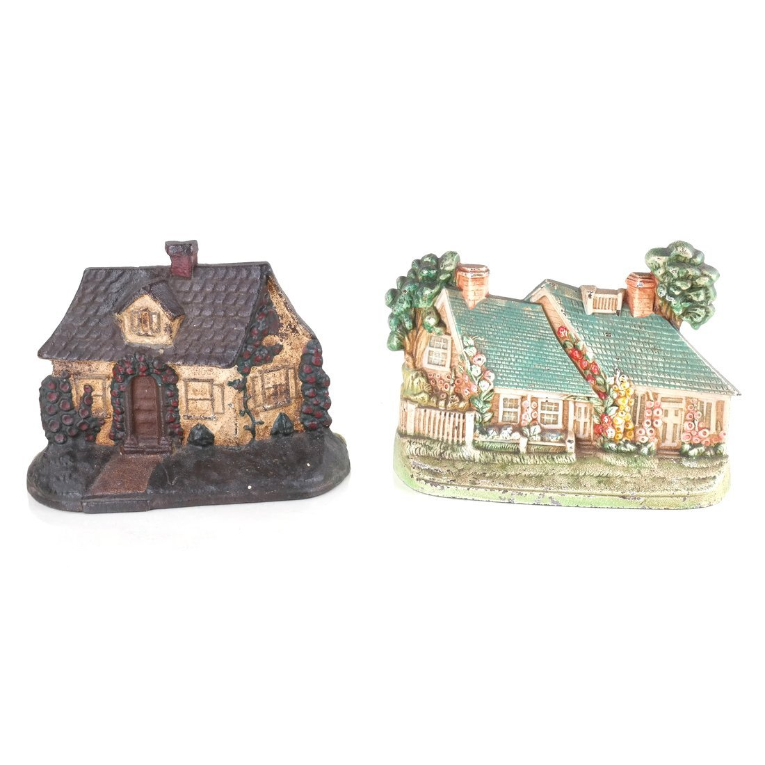 Two Painted Cast Iron Cottage Doorstops