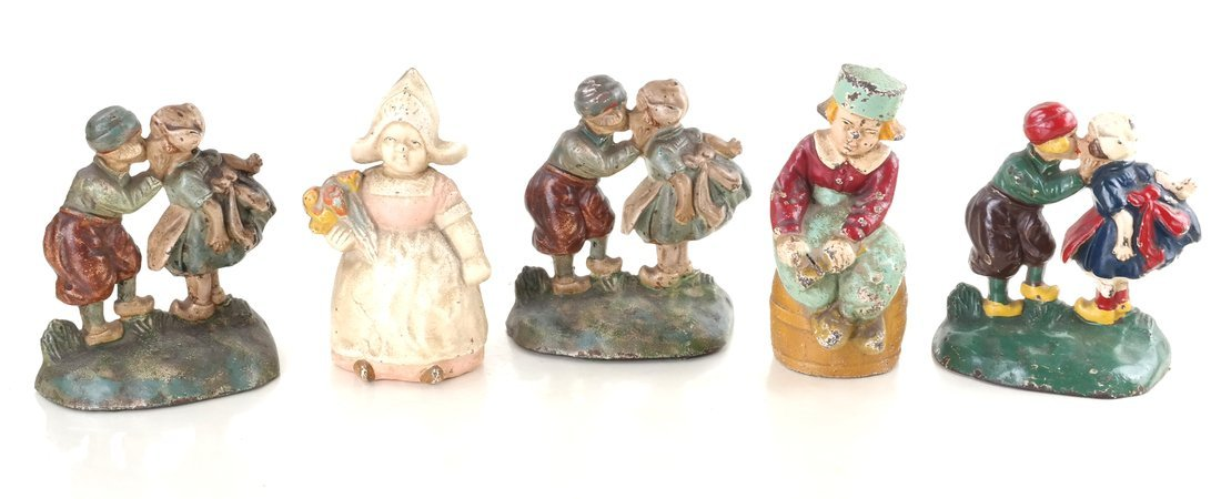 Five Painted Cast Iron Dutch Children