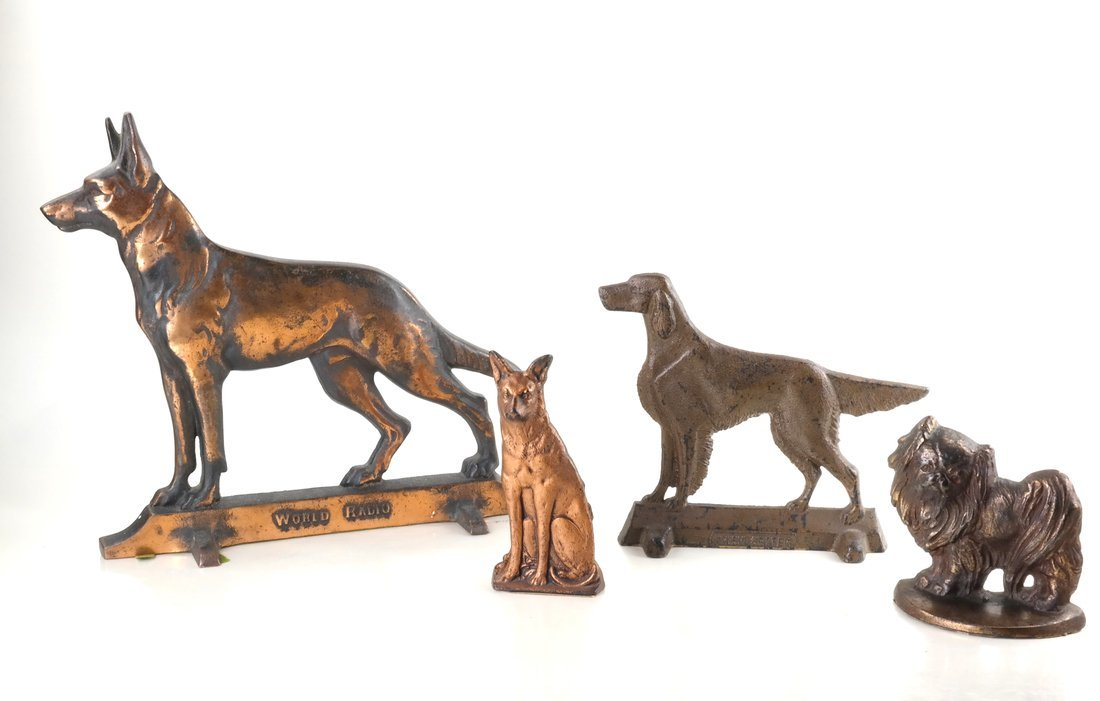 Four Cast Metal Dogs