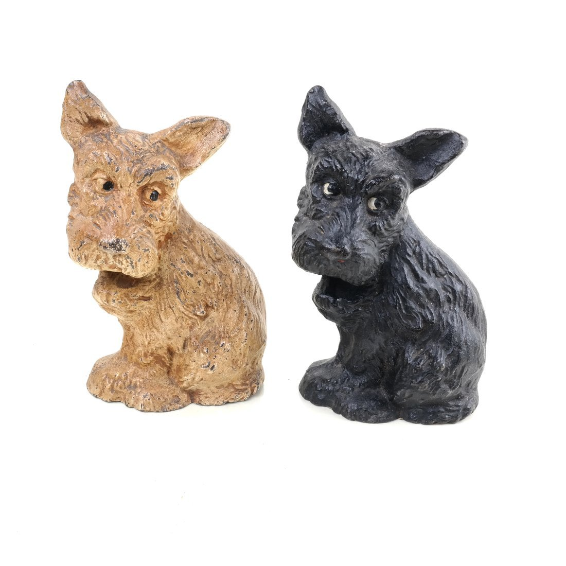 Two Painted Cast Iron Seated Dogs