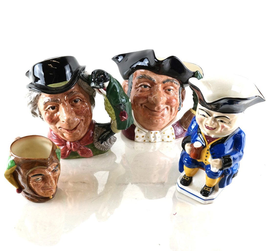 Four Staffordshire Toby Jugs