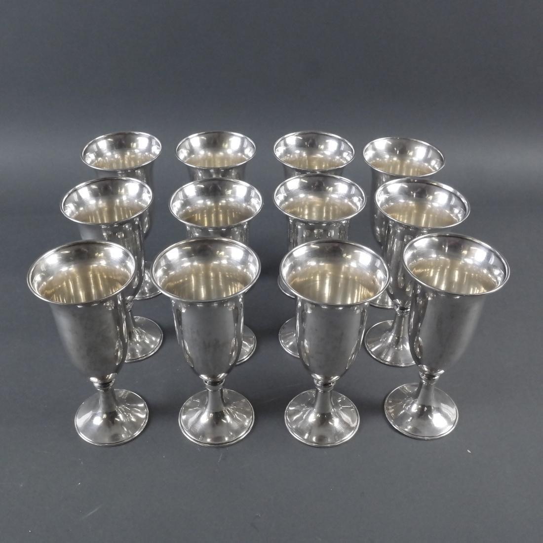 Set Twelve .900 Standard Silver Goblets
