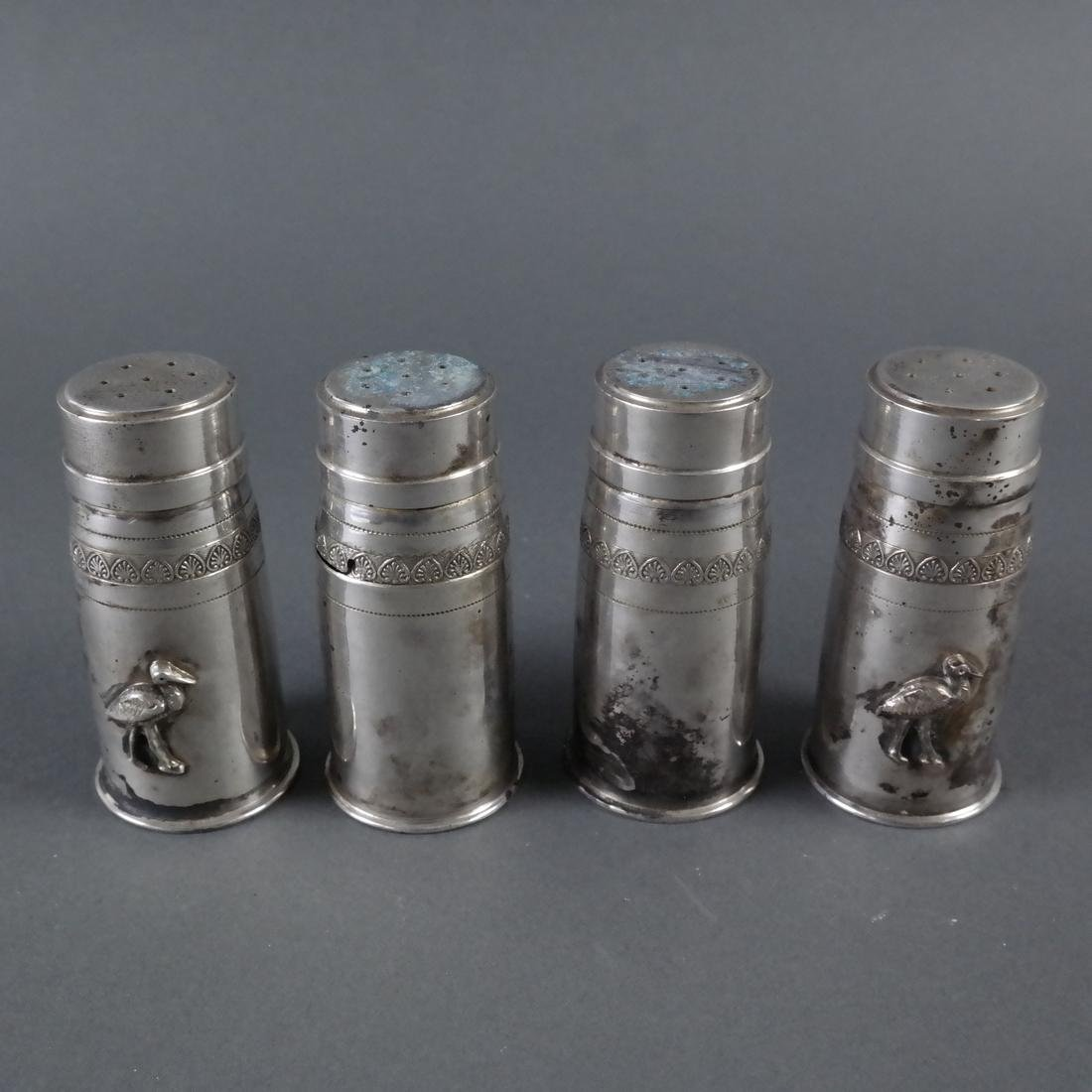 Four .900 Standard Silver Casters