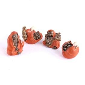 Four Japanese Glazed Mud Figures