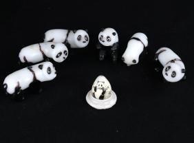 Seven Miniature Panda Figures