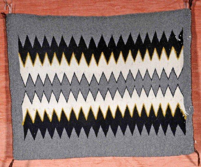"17: Navajo Indian Eye Dazzler Blanket.  2' 1"" x 1' 8""."