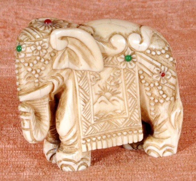 "11: Carved Ivory Bejeweled Elephant.  2 1/4"" H x 2 1/2"""
