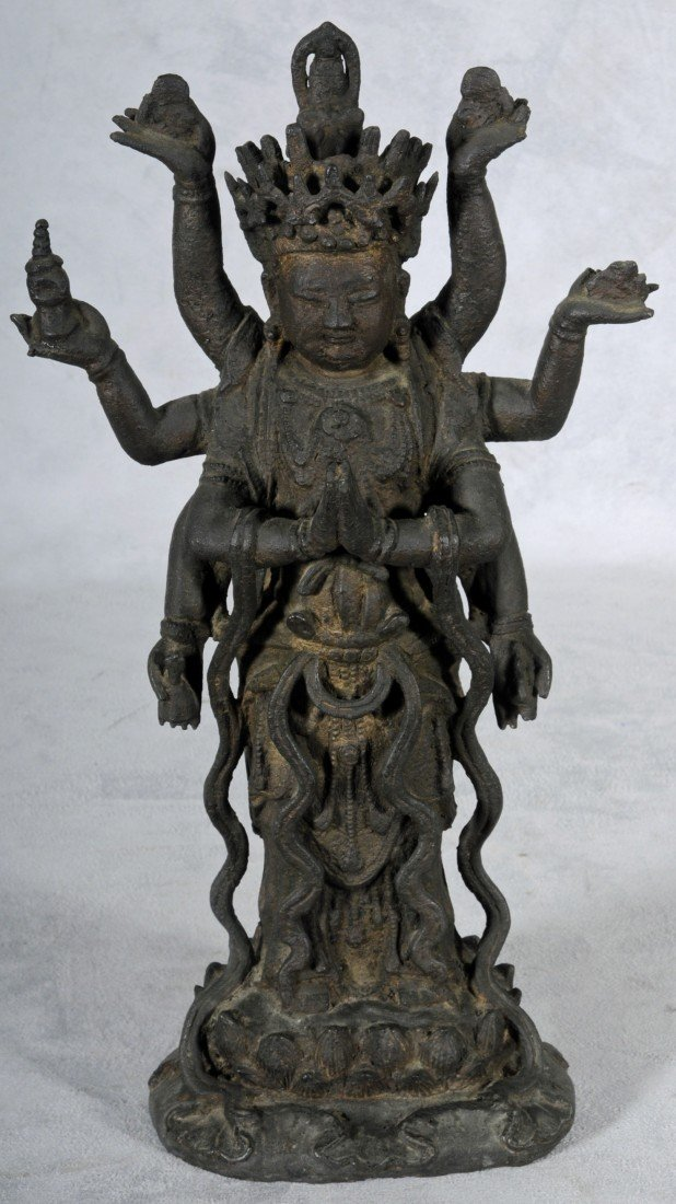 759: EARLY 19TH C. SOUTH EAST ASIAN BRONZE FIGURE IN A