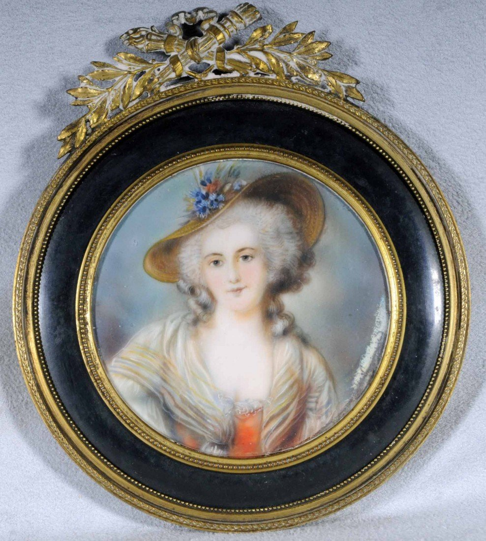 11: ROUND HAND PAINTED MINIATURE OF A LADY WEARING A ST