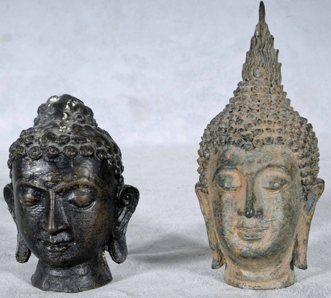19: 2 BRONZE BUDDHA'S HEADS. HEADS HAVE ELONGATED EARS.