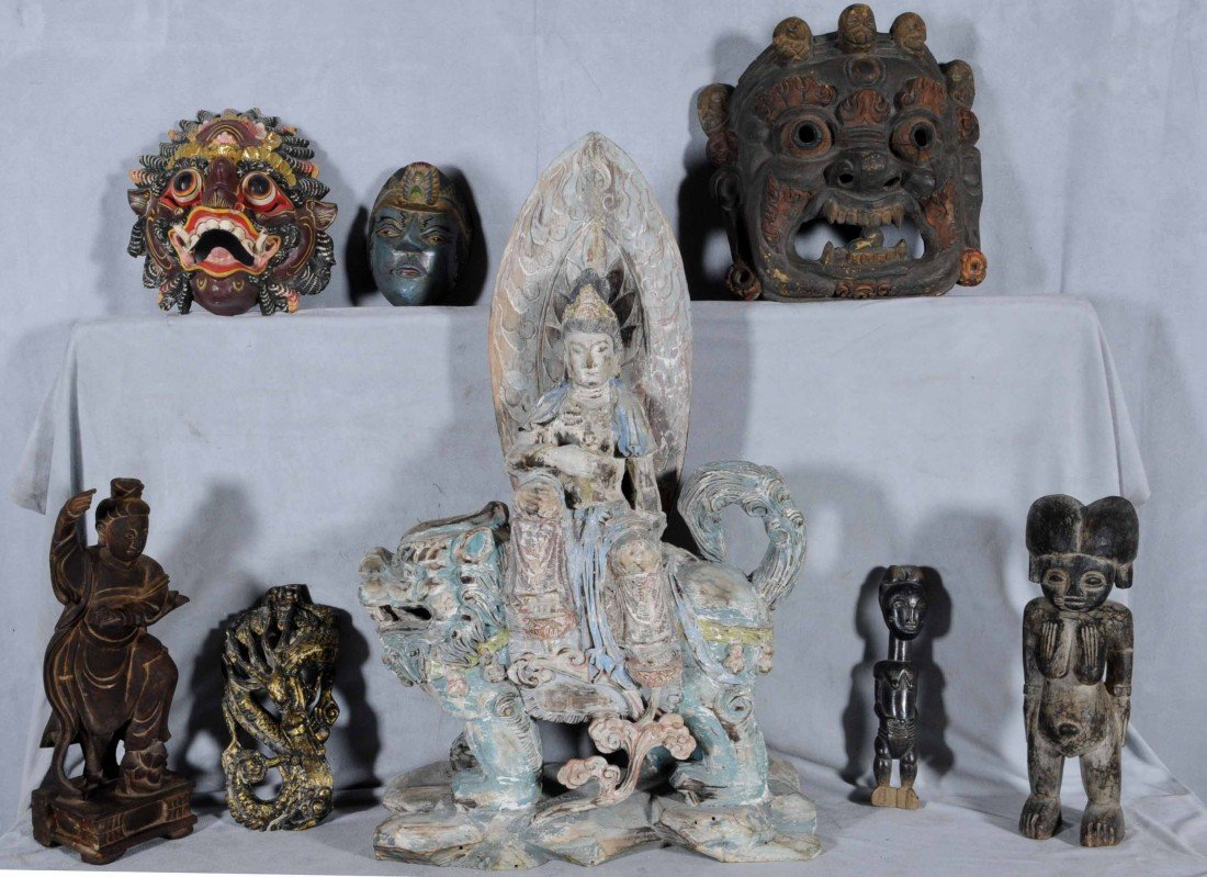 23: LOT OF 7 WOOD CARVED PIECES. 3 MASKES, 2 AFRICAN FI