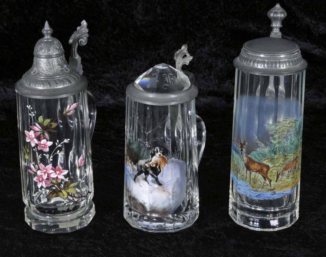 11: 3 ANTIQUE GERMAN GLASS BEER STEINS. EACH HAS ENAMEL