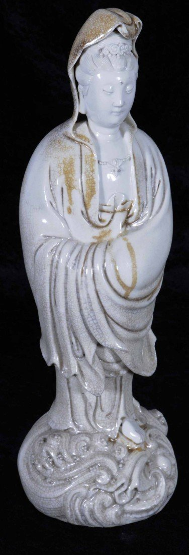 13: CHINESE PORCELAIN FIGURE OF KWAN YIN STANDING ON A