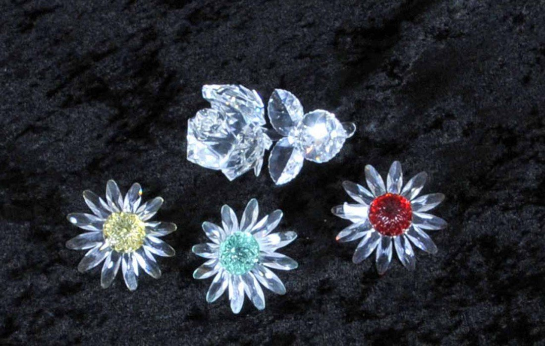 13: 4 SWAROVSKI GLASS FLOWERS. CONSISTING ON A ROSE & 3