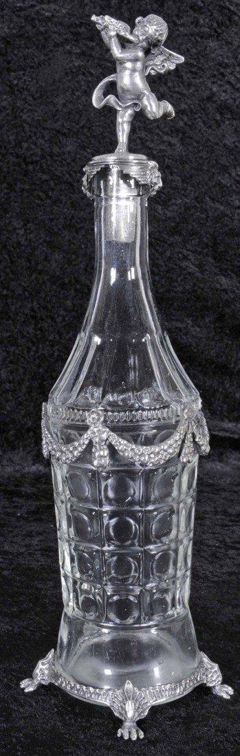 18: SILVER PLATED & GLASS CRUET BOTTLE. WINGED FIGURE O