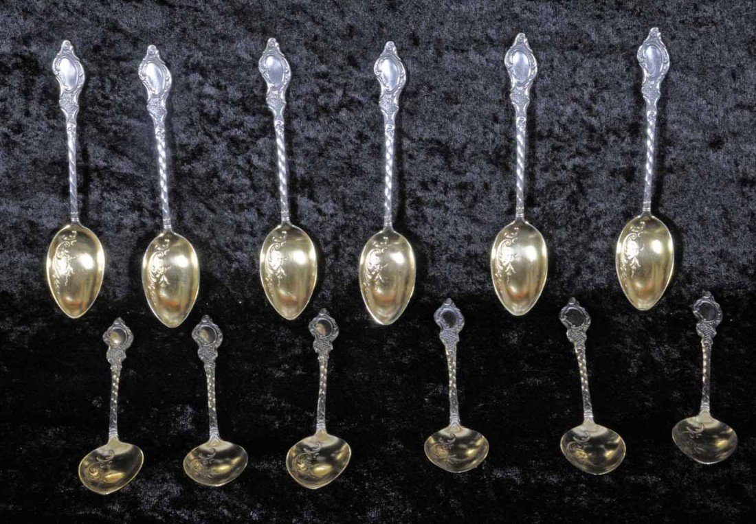 21: 12 SILVER DEMI-TASSE SPOONS WITH GILT WASHED BOWLS.