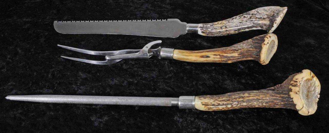 24: 3 PC. HORN HANDLED CARVING SET. KNIFE, FORK & KNIFE