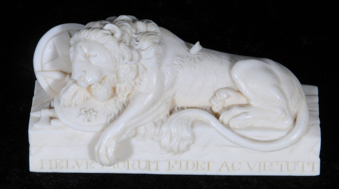 "14: CARVED IVORY FIGURE OF A LION.  2"" H X 3 3/4"" W."