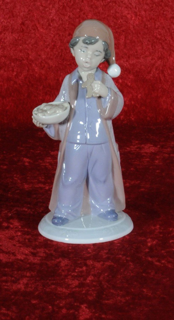 238: LLADRO PORCELAIN FIGURINE OF A YOUNG BOY. FROM THE