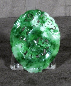 OVAL CHINESE CARVED APPLE JADE PANEL. CARVED DRAGON
