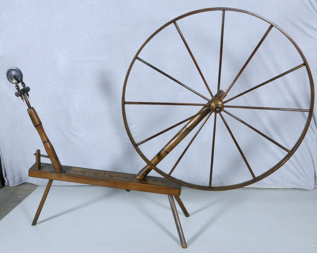 70: LG. ANTIQUE SPINNING WHEEL W/ A PAINTED FINISH.  58