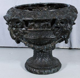 BRONZE PLANTER W/ 4 RAM'S HEAD HANDLES WITH FLORAL