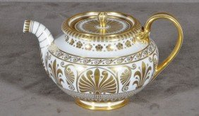 RUSSIAN PORCELAIN TEAPOT. WHITE BACKGROUND W/ GILT