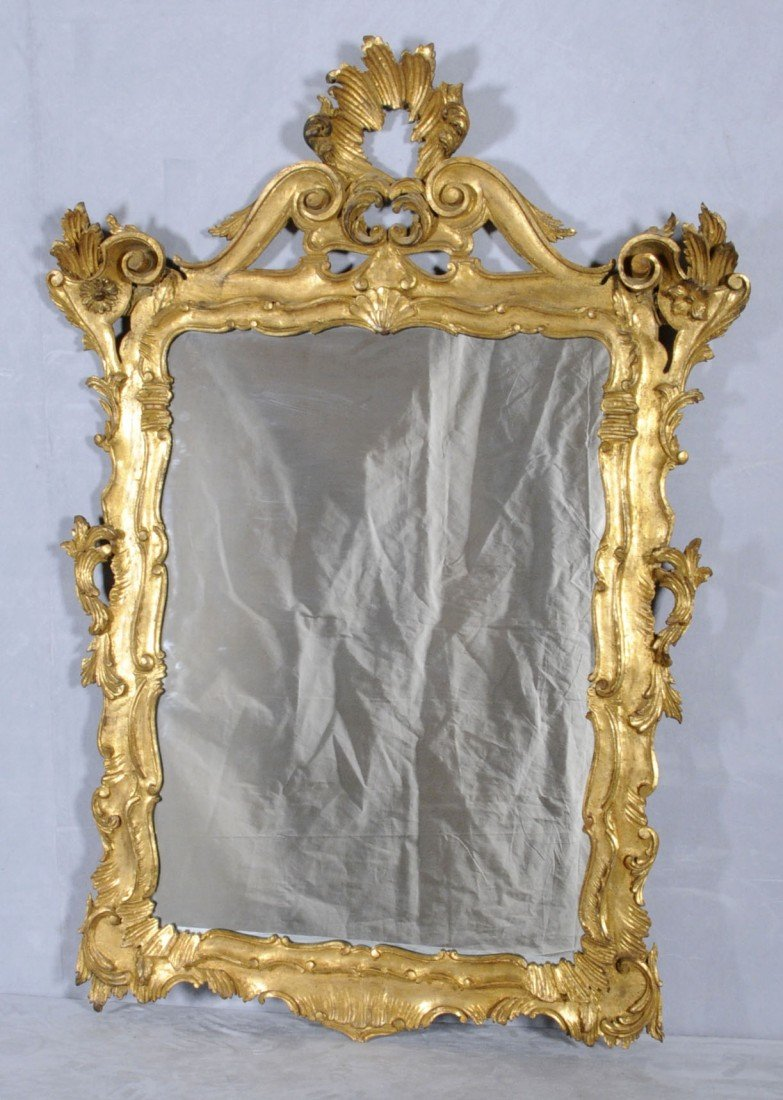148: ITALIAN CARVED GILTWOOD WALL MIRROR. FLORAL AND SC