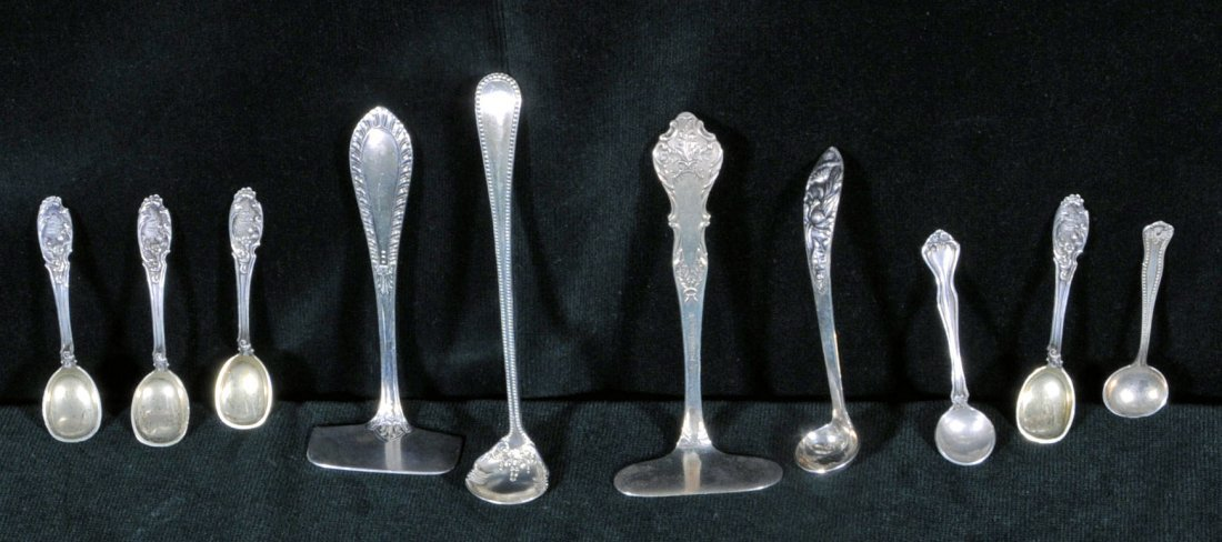 23: 10 PC. SILVER & S.P. SPOONS & PUSHERS. PUSHERS ARE