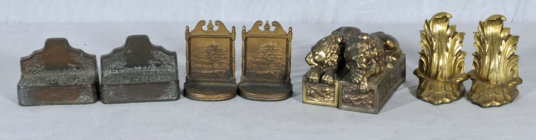 3: 4 PAIRS OF METAL BOOK ENDS. ONE PAIR IS MARKED BRADL