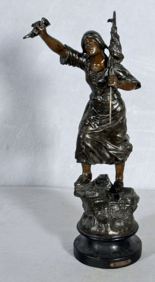 17: ANTIQUE SPELTER SCULPTURE OF A LADY. FIGURE IS HOLD