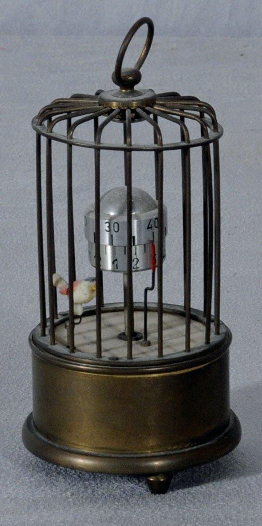 19: BRASS BIRDCAGE ORBITAL CLOCK WITH THE BIRD AS A SEC
