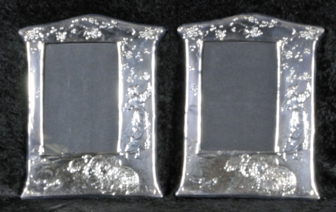 23: PAIR OF STERLING SILVER EASEL BACK PICTURE FRAMES.