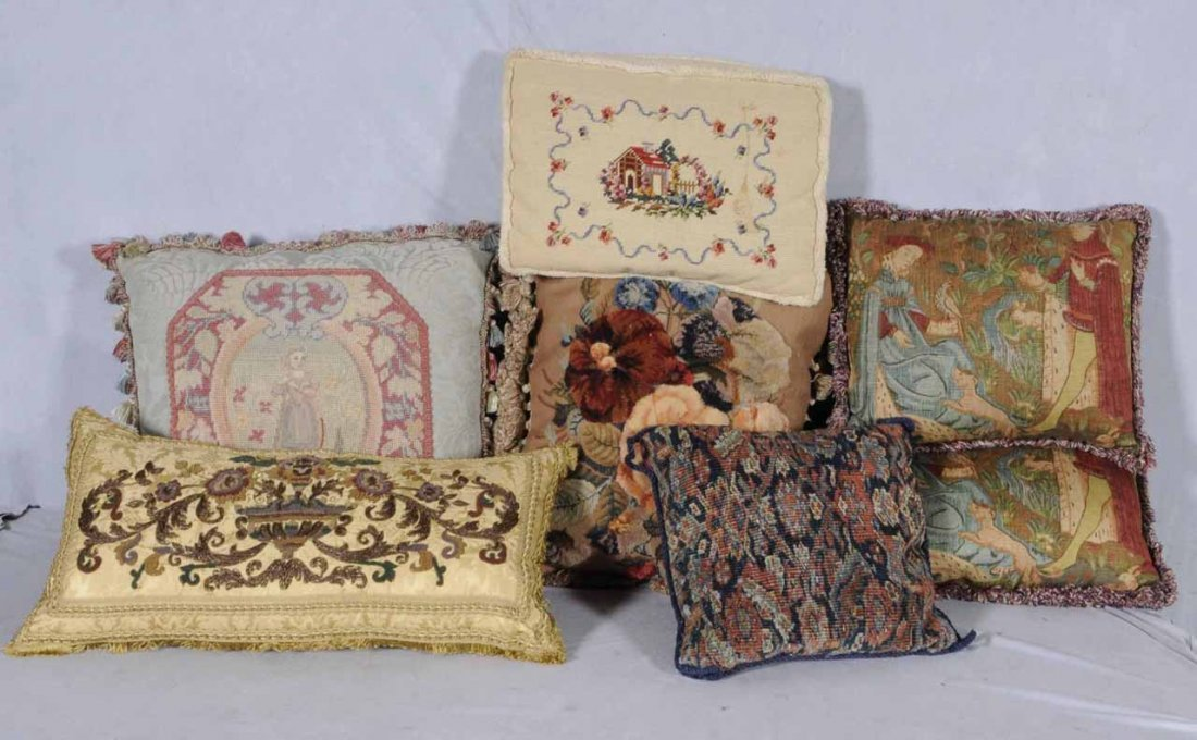 8: 7 THROW PILLOWS SOME WITH FLORAL DECORATION.  THREE