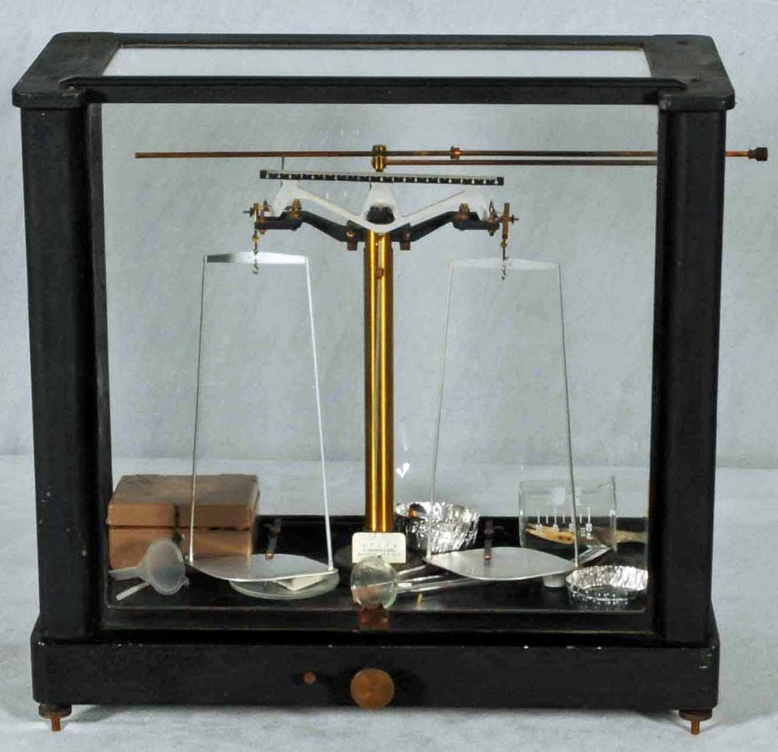 55: ANTIQUE GOLD SCALE IN A BLACK & GLASS CASE. A. DHAL