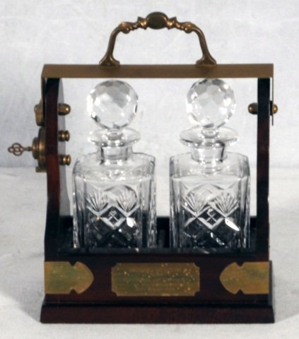 18: ENGLISH 2 BOTTLE TANTALUS SET WITH CUT GLASS DECANT