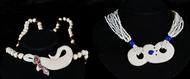 22: 2 ORIENTAL  NECKLACES.  ONE CARVED IVORY W/ RIBBON