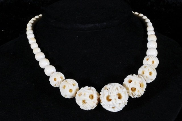24: CHINESE CARVED IVORY CONCENTRIC BALL NECKLACE. GOOD