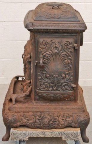 104: ANTIQUE CAST IRON POT BELLY STOVE. FIGURAL DECORAT - 2