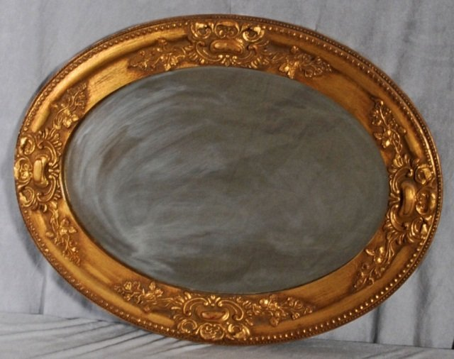 15: SMALL OVAL GILT WALL MIRROR WITH FLORAL DECORATION