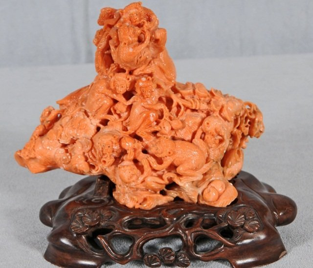216: ORIENTAL CORAL  CARVING OF APPROX. 20 MONKEYS. RES