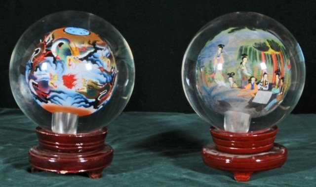 23: PAIR OF INSIDE PAINTED GLASS BALLS.  MULTI-COLOR FI