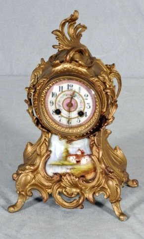 22: GILT ORMOLU MANTEL CLOCK.   PORCELAIN FACE & PORCEL