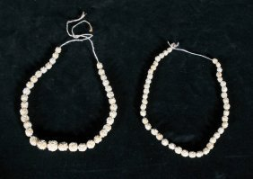 2 STRANDS OF FLORAL CARVED IVORY BEADS. GOOD. NEED TO B