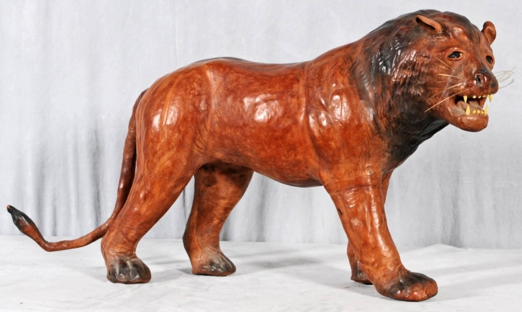 "LEATHER FIGURE OF A LION WITH GLASS EYES. GOOD. 17"" H X"