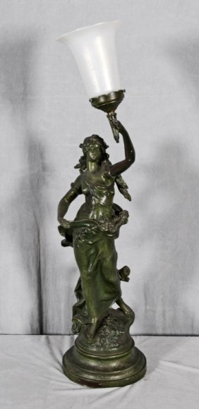 SPELTER FIGURAL LAMP DEPICTING A LADY HOLDING A LIGHT.